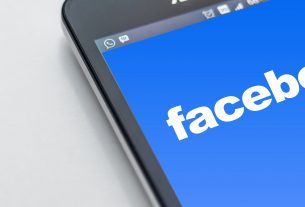 Facebook logo on a mobile phone